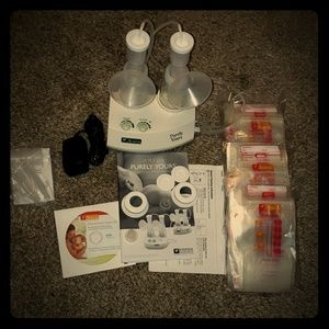 Ameda double electric breast pump & storage bags!